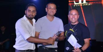 ADNAN IQBAL STANDING IN CENTER RECEIVING AWARD OF THE BEST PR MEDIA AGENCY IN MIDDLE EAST